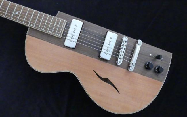 Osiris, Guitare Voyageuse et Modulaire - réalisée par Hervé BERARDET Artisan Luthier, atelier Guitare et Création - demi noyer et côtés poirier